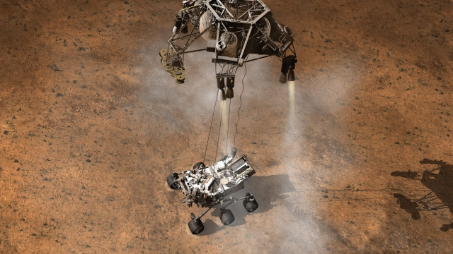 Curiosity touches down on Mars after being lowered by its Sky Crane.<br />NASA artwork, from http://www.nasa.gov/centers/ames/images/content/705850main_Curiosity.jpg (larger image) 705850main_Curiosity-640x360.jpg