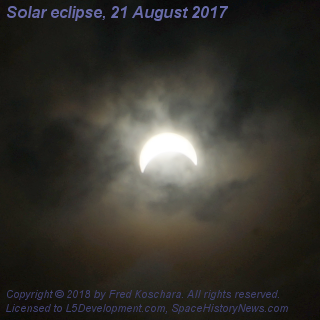 Solar eclipse through mostly cloudy skies, Medford, Massachusetts, USA21 August 2017 14:41:04 EDTCopyright © 2018 by Fred Koschara 20170821-A9025412.crop.2600,1780.gamma.1.5.png